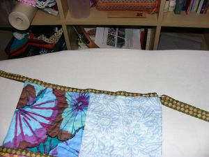 Pin piping to top edge of the peg bag.