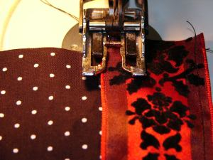 Sew down the bottom edge of the ribbon